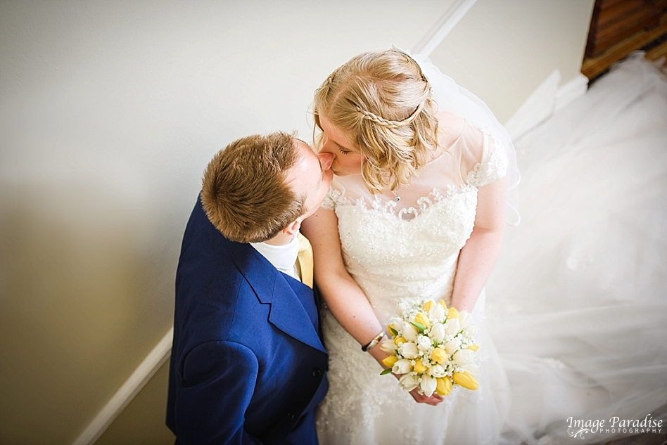 Bride & groom kissing on the stairs at No4 Clifton village Bristol - The Rodney hotel