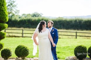 Bride and groom in the gardens of Hyde barn