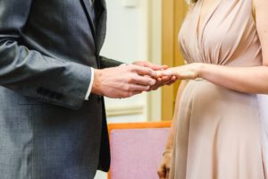 couple exchange rings at their elopement wedding