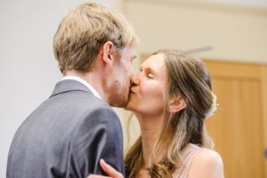couple seal their vows with kiss