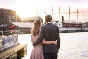 wedding couple watch the sunset over the SS Great Britain