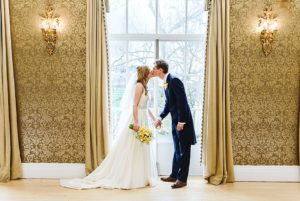 Bride & groom share a kiss in the Clifton Pavilion at their Bristol zoo wedding