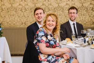 guests laughing at the best mans speech at Bristol zoo wedding