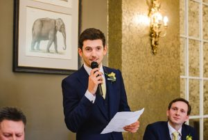 Best man talking into microphone at a Bristol zoo wedding