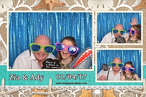 inflatable shark, silly sun glasses are worn in this beach themed wedding photo booth