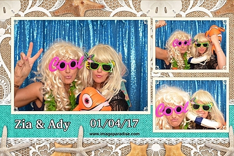 Bristol Beach themed wedding photo booth of two ladies dress in blonde wigs and sunglasses