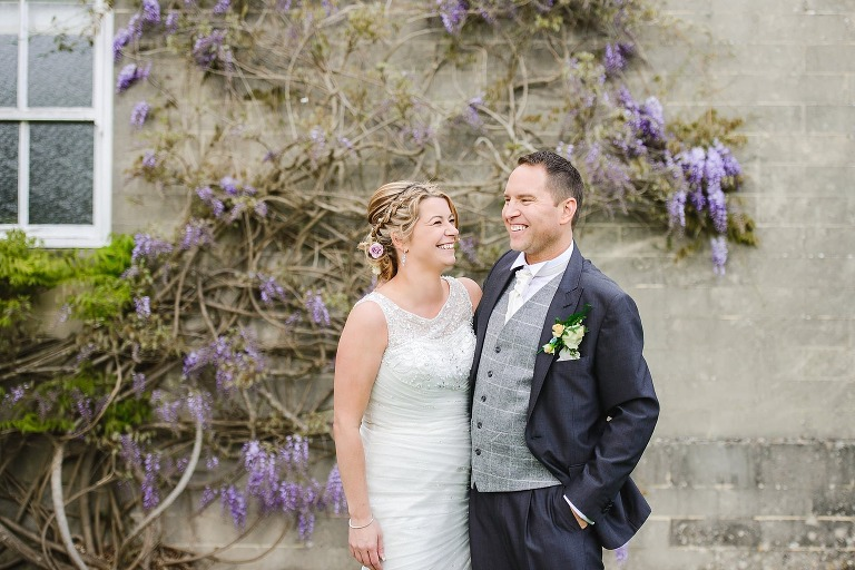 Happy Couple in the gardens of Leigh Park Hotel by Bradford on Avon photographer