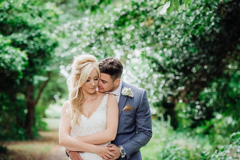 Bride & Groom in the garden of Hatherley Manor wedding venue Gloucestershire