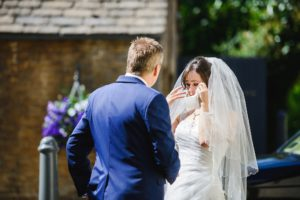 Emotional bride crying just before her wedding at the Hare and Hounds