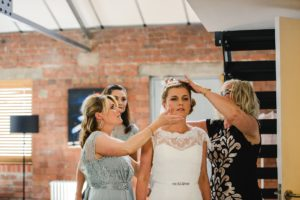 Bride getting ready with bridal party at the Paintwork's