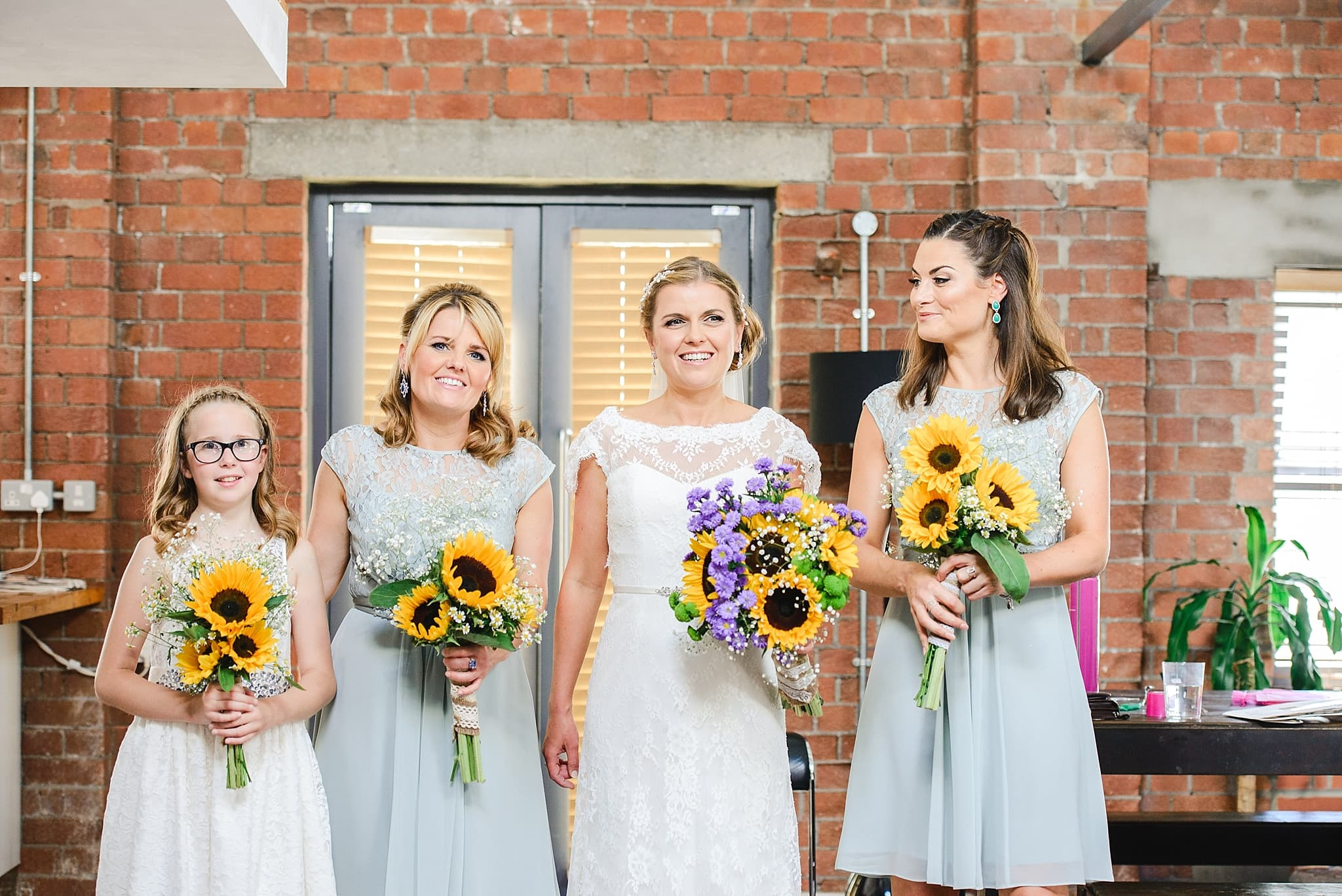 Bridesmaids lined up before the wedding at the apartments in the paintworks
