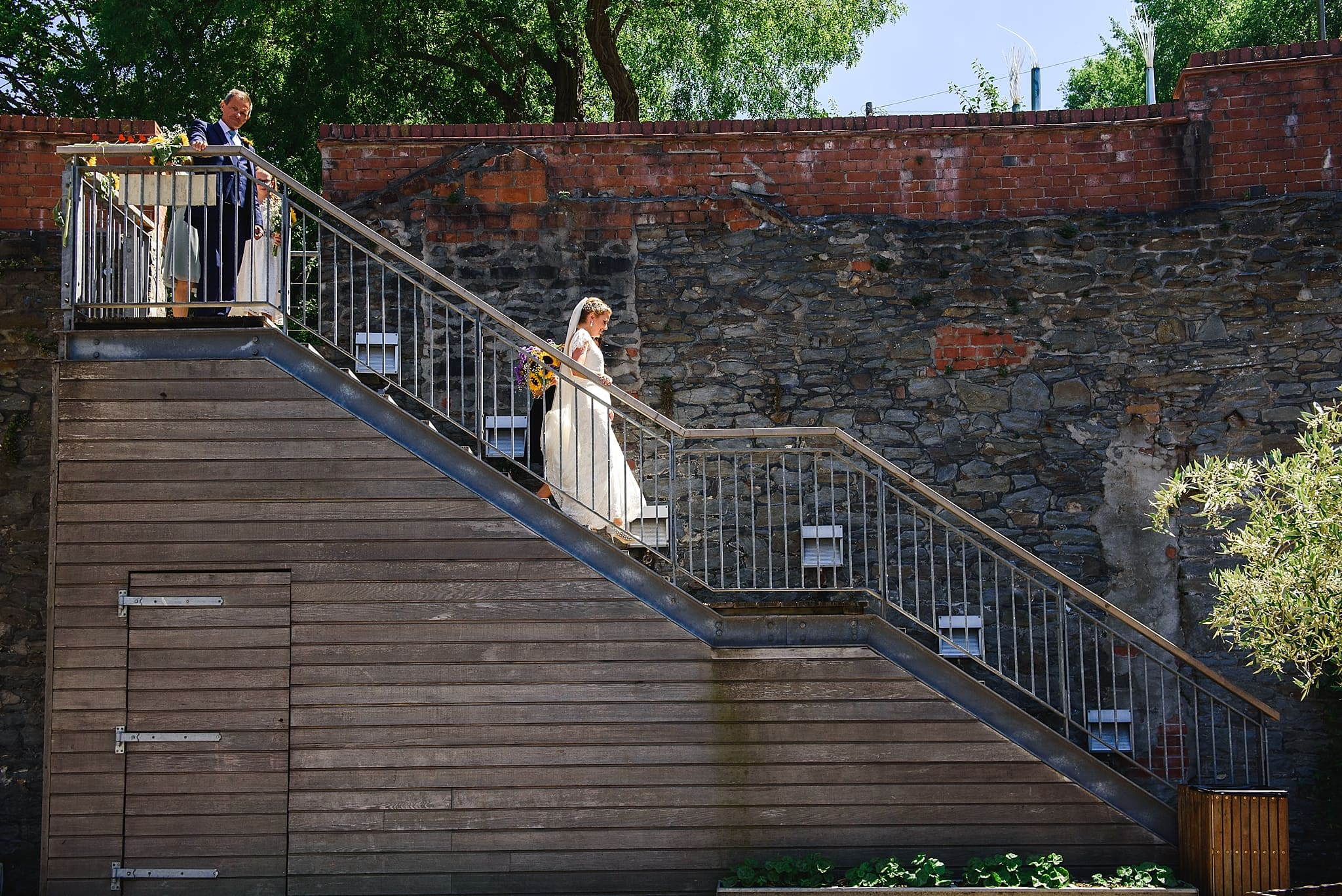 Bride walking down the stairs to her Paintwork's wedding