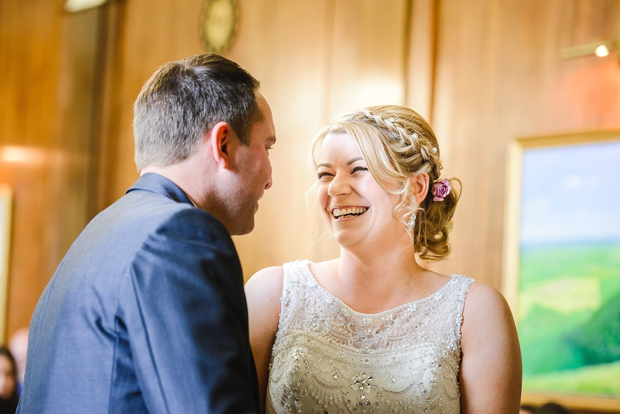 Bride laughing at her groom at their Trowbridge registry office ceremony