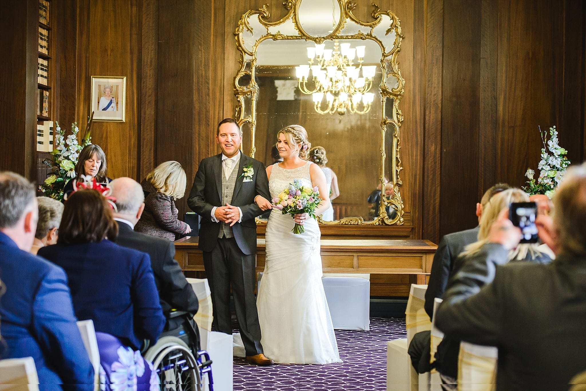 Bride and groom stood in the members room at Trowbridge registry office
