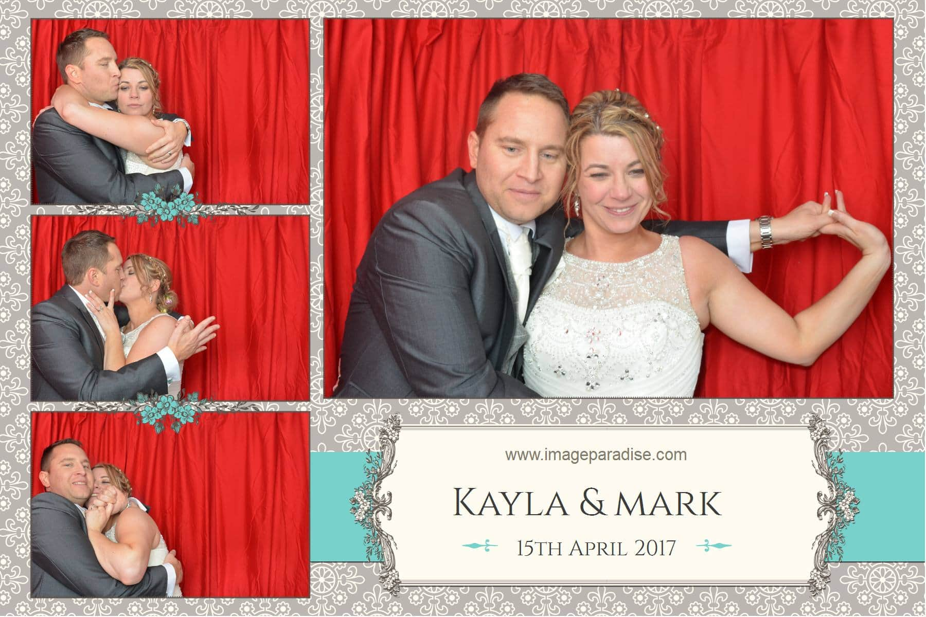 Bride and groom in a red curtain photo booth Bradford on Avon