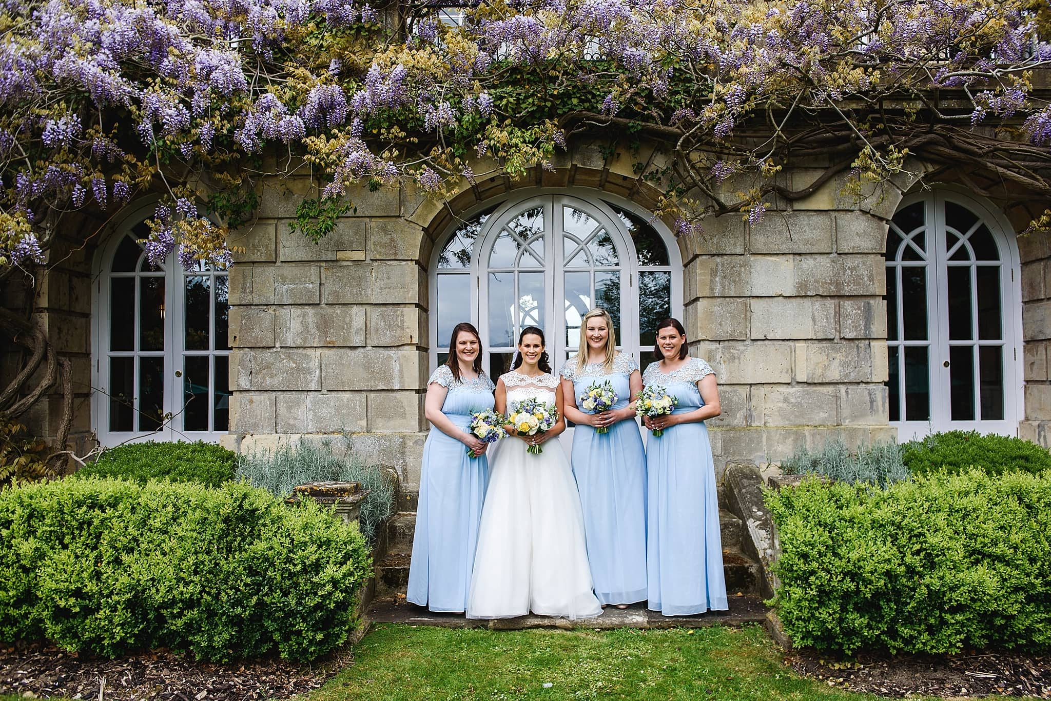Bridesmaids stood in the garden of Bailbrook House