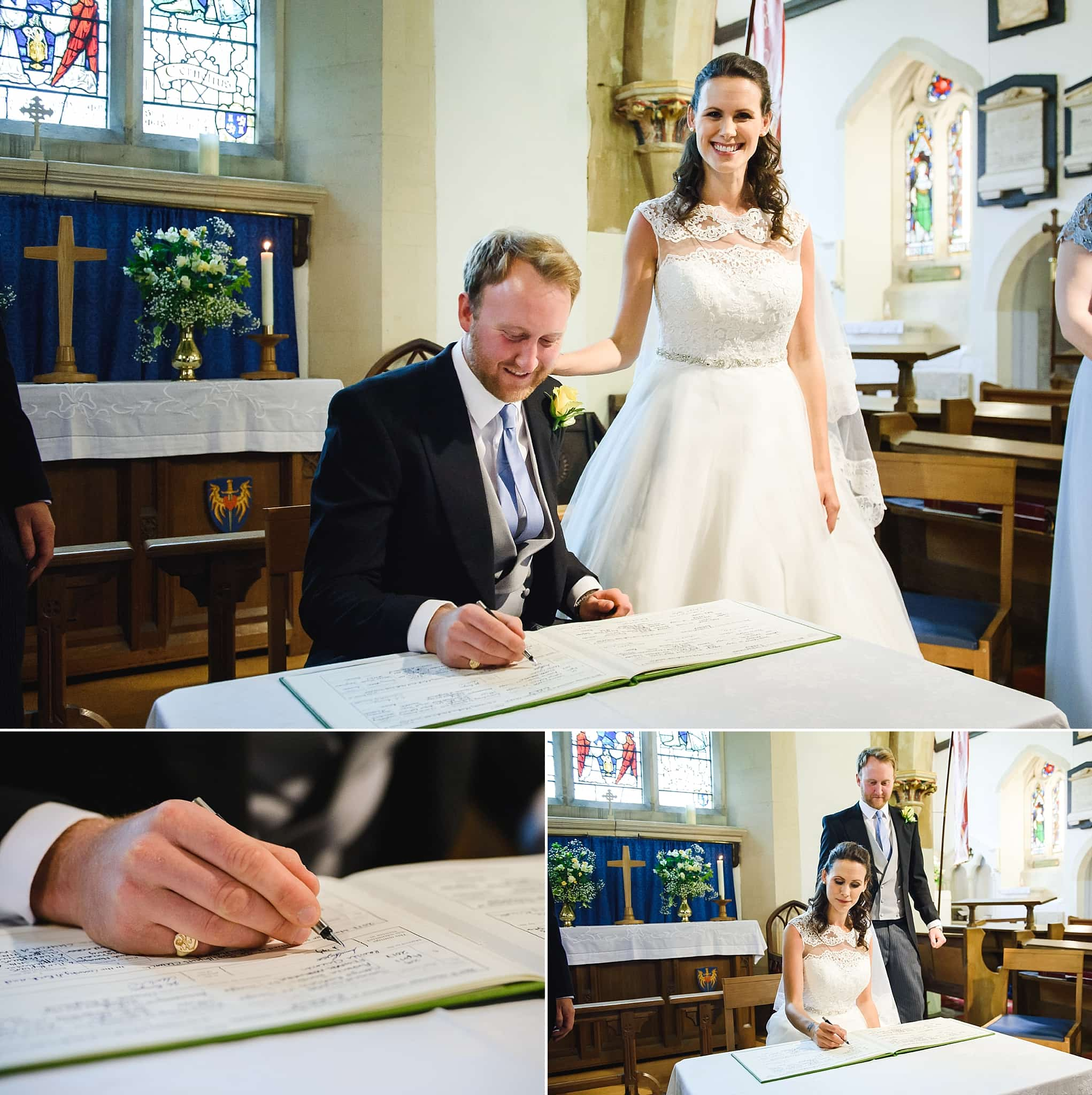 Bride and groom sign the register at St Swithins church, Bathford