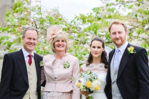 Family formals outside St Swithins church, Bathford