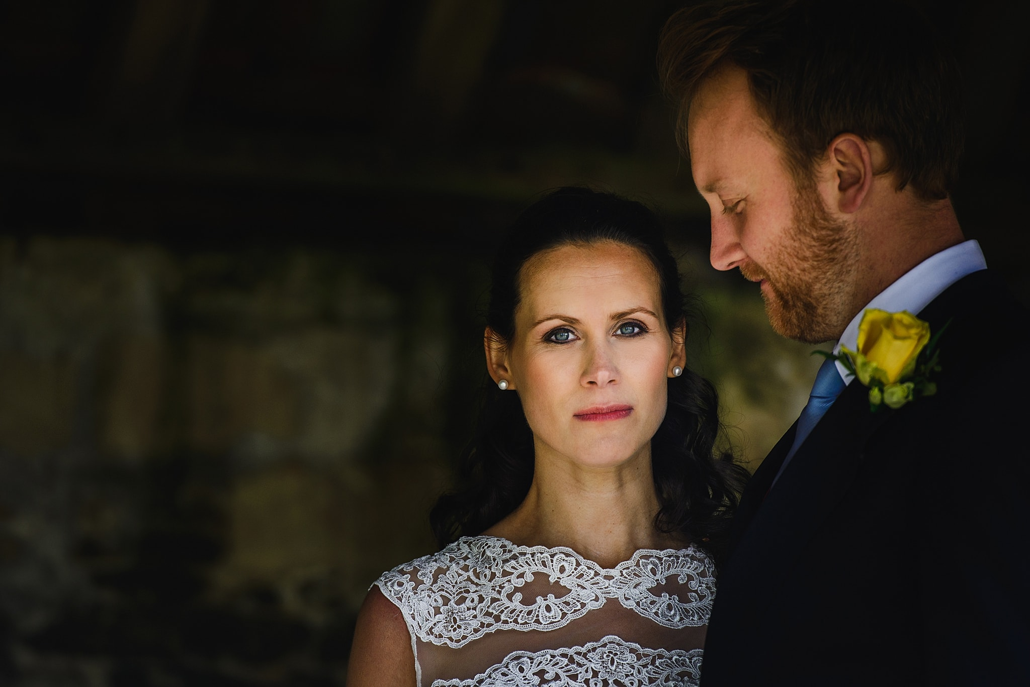 Bride and groom stood inside a barn at Wick Farm wedding venue