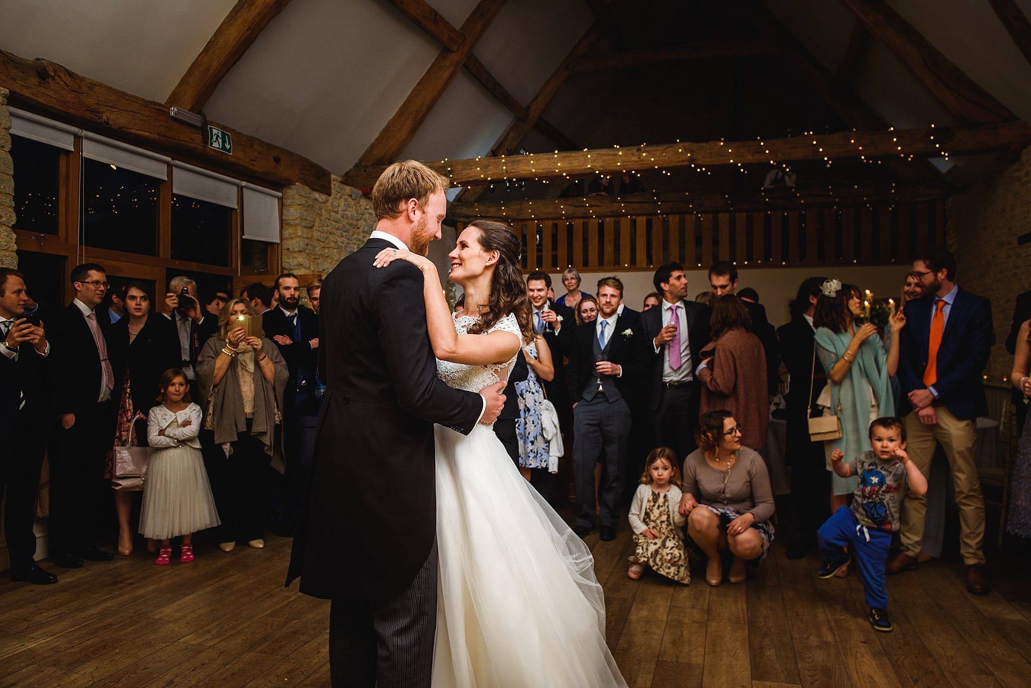 Couple have their first dance in front of guests at Wick Farm