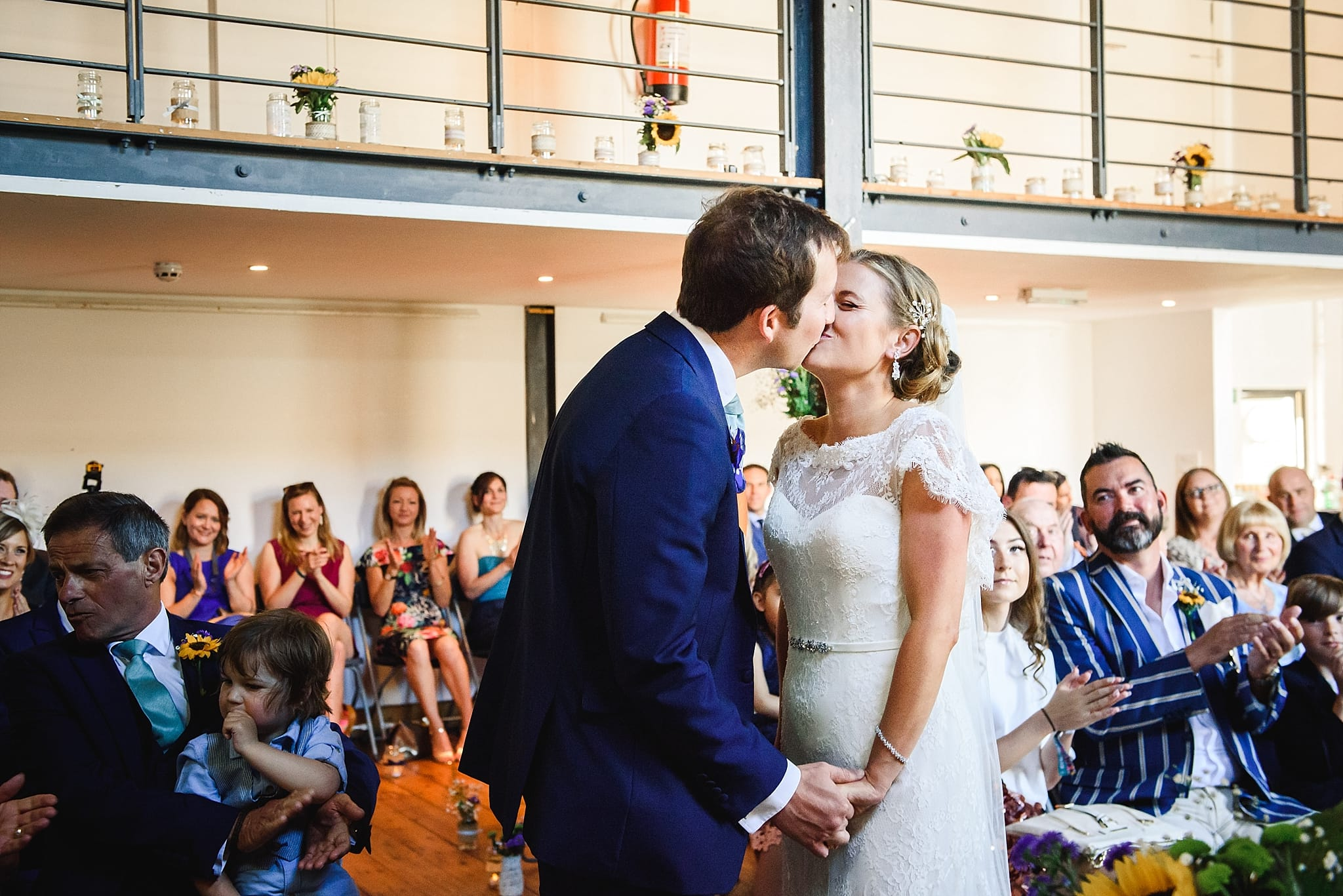 couple having their first kiss as husband and wife at their paintwork's wedding