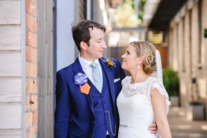 Couple stare into each others eyes in the industrial area of their Paintwork's wedding Bristol