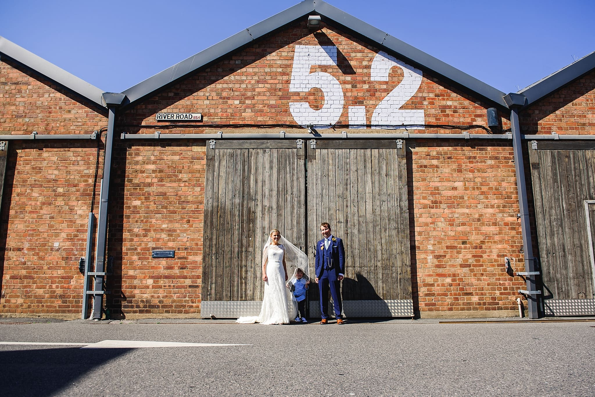 Couple stood in front of Unit 5.2 at their paintwork's wedding