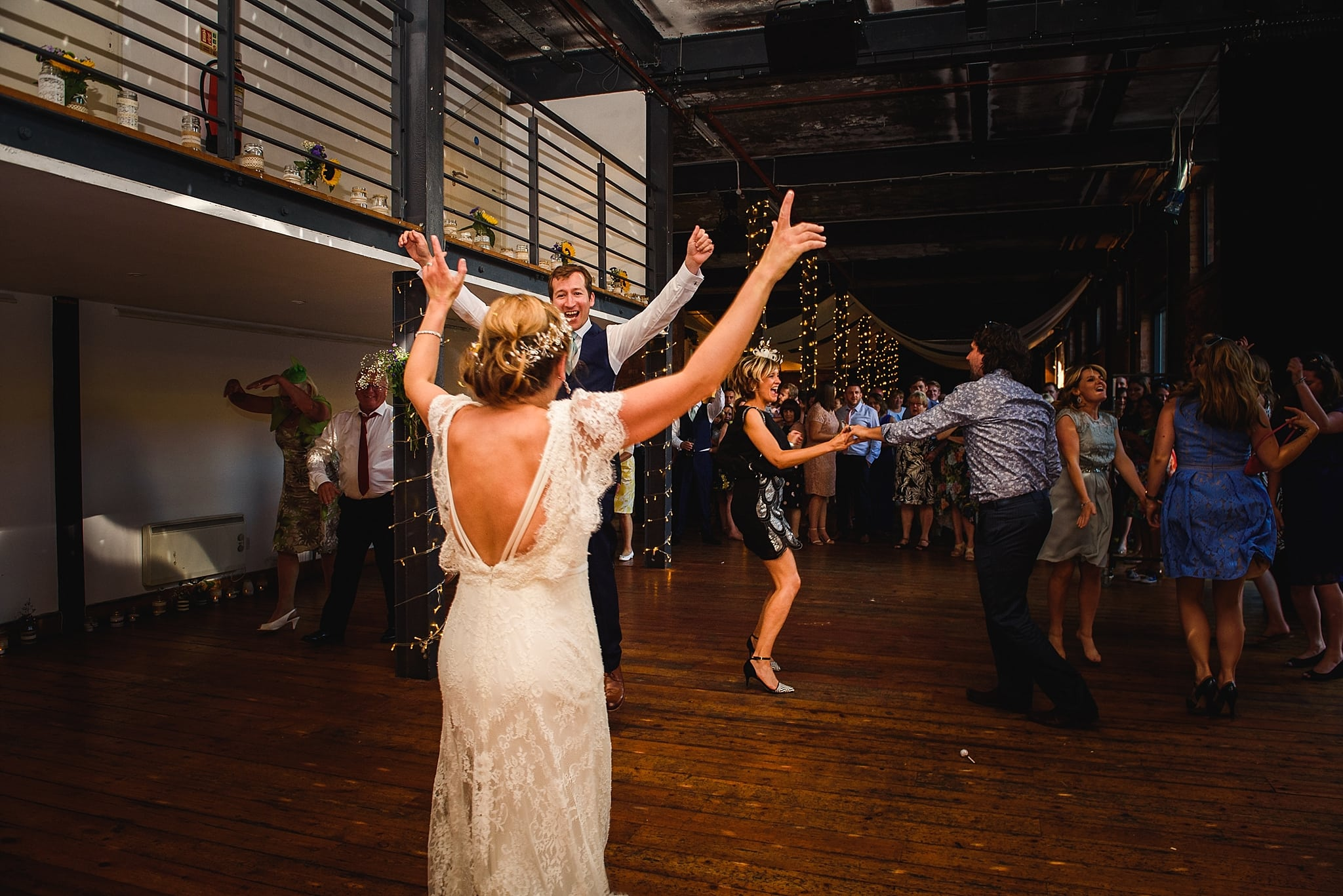 Couple dance to rock music on their wedding night